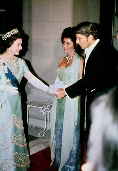 Queen Elizabeth II meets Elizabeth Taylor and husband John Warner at a gale dinner in Washington in July 1976.  (Anwar Hussein/WENN.COM)