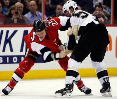Ottawa Senators' Chris Neil (25) fights Pittsburgh Penguins' Deryk Engelland (5) during the first period of NHL action at Scotiabank Place. (DARREN BROWN/OTTAWA SUN/QMI AGENCY)