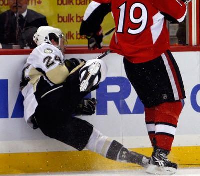 Ottawa Senators' Jason Spezza (19) checks Pittsburgh Penguins' Matt Cooke (24) into the boards during the first period of NHL action at Scotiabank Place. (DARREN BROWN/OTTAWA SUN/QMI AGENCY)