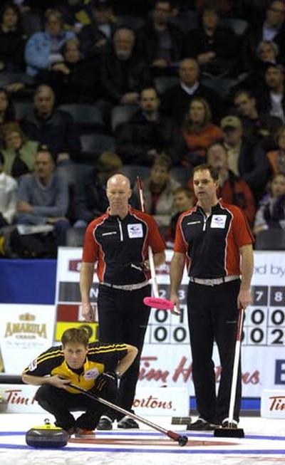 Ontario skip Glenn Howard, right, and third Richard Hart watch as New Brunswick third Charlie Sullivan calls in a shot during  a 5-4 loss to James Gratten's New Bruinswick team on opening day at the 2011 Tim Horton's Brier at the John Labatt Centre MORRIS LAMONT / THE LONDON FREE PRESS / QMI AGENCY