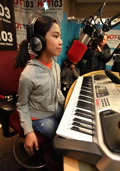 Young singer Maria Aragon (left), 10, visited the HOT 103 studio in Winnipeg Feb. 17, 2011. (MARCEL CRETAIN/Winnipeg Sun)