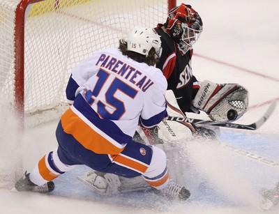 The Ottawa Senators played the New York Islanders at Scotiabank Place in Ottawa February 15, 2011. Ottawa Senator Brian Elliott makes a save against New York Islander P A Parenteau during first period action Tuesday.   TONY CALDWELL/OTTAWA SUN