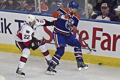 Edmonton's Jim Vandermeer battles with Ottawa's Chris Kelly during the Edmonton Oilers game against the Ottawa Senators at Rexall Place in Edmonton on Saturday, February 12, 2011. (CODIE MCLACHLAN/EDMONTON SUN)