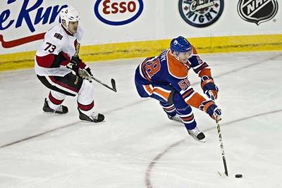 Edmonton's Liam Reddox is pursued by Ottawa's Jarko Ruutu during the Edmonton Oilers game against the Ottawa Senators at Rexall Place in Edmonton on Saturday, February 12, 2011. (CODIE MCLACHLAN/EDMONTON SUN)