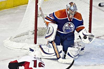 Edmonton's Nikolai Khabibulin won't let Ottawa's Bobby Butler in during the Edmonton Oilers game against the Ottawa Senators at Rexall Place in Edmonton on Saturday, February 12, 2011. (CODIE MCLACHLAN/EDMONTON SUN)