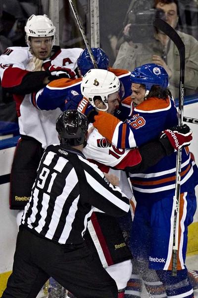 Edmonton's Ryan Jones and Ottawa's Bobby Butler mix it up during the Edmonton Oilers game against the Ottawa Senators at Rexall Place in Edmonton on Saturday, February 12, 2011. (CODIE MCLACHLAN/EDMONTON SUN)