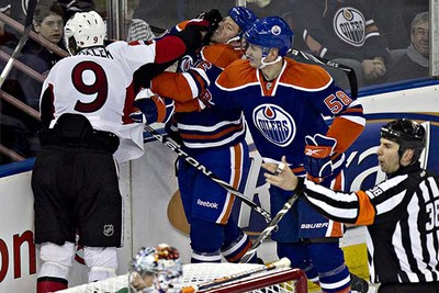 Edmonton's Colin Fraser fights Ottawa's Milan Michalek during the Edmonton Oilers game against the Ottawa Senators at Rexall Place in Edmonton on Saturday, February 12, 2011. (CODIE MCLACHLAN/EDMONTON SUN)