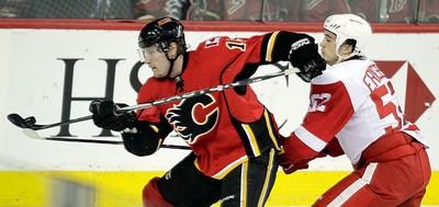 Calgary Flames Tim Jackman and Jonathan Ericsson of the Detroit Red Wings during NHL hockey  in Calgary, Alberta, Friday January 7, 2011. AL CHAREST/CALGARY SUN/QMI AGENCY