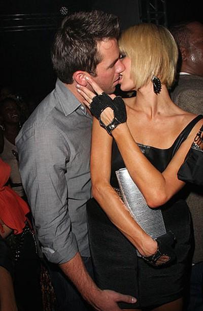 Paris Hilton kissing her (now ex) boyfriend Doug Reinhardt at Queen Latifah's Birthday Party in Los Angeles on March 28, 2009. (WENN.COM file photo)