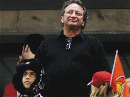 Senators owner Eugene Melnyk salutes the fans after Thursday's final home game of the season. (ERROL McGIHON/Ottawa Sun)