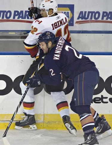 Edmonton Oilers Jim Vandermeer shoves Calgary Flames Jerome Iginla during NHL action at Rexall place. (JORDAN VERLAGE/EDMONTON SUN)