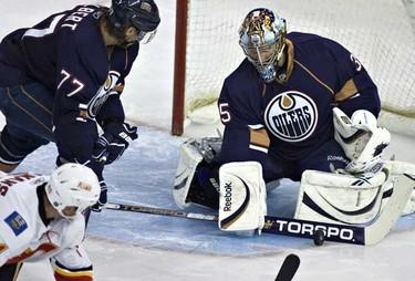 The Edmonton Oilers Nikolai Khabibulin make a save during NHL action at Rexall place. (JORDAN VERLAGE/EDMONTON SUN)