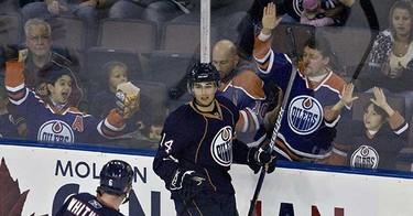 Fans cheer after Edmonton Oilers Jordan Eberle scored on the Vancouver Canucks during first period NHL preseason action at Rexall Place on Sunday, September 26 2010, in Edmonton, Alta. (AMBER BRACKEN/EDMONTON SUN)