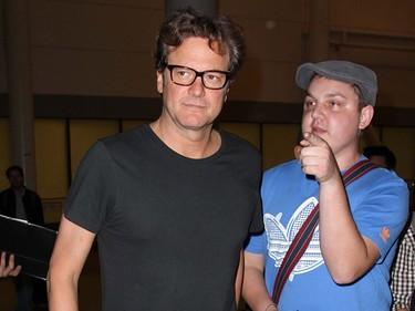 Colin Firth arrives at Toronto Pearson International Airport to attend the Toronto International Film Festival. (John White, QMI Agency)
