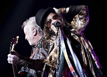 Steve Tyler of Aerosmith interacts with Brad Whitford at Rexall Place in Edmonton, Alberta, on Tuesday. CODIE MCLACHLAN / EDMONTON SUN