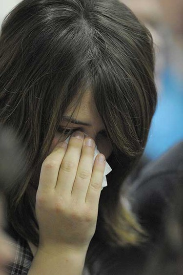 Oct. 3, 2008: A mourner during Emily Joy Stauffer's memorial service in Edson, Alberta. ((Larry Wong/Sun Media))