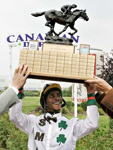 Jockey Rico Walcott hold the trophy after winning the Northland Park Canadian Derby on Saturday August 21, 2010 in Edmonton. (Jason Franson/ EDMONTON SUN)