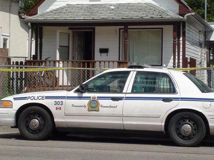 A police car sits outside a house.