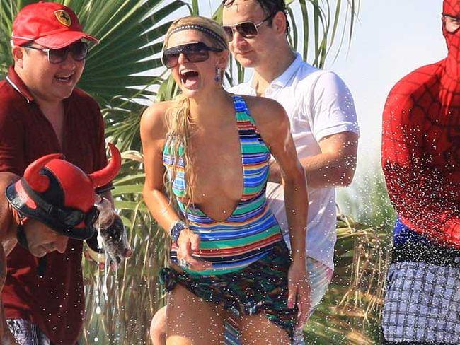 Paris Hilton parties at La Voile Rouge on Pampelonne beach in St. Tropez, France  July 22, 2010. (WENN.com)