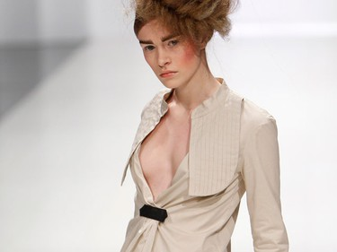 A model presents a creation by Ukrainian designer Irina Krasilnikova during Ukrainian Fashion Week in Kiev March 15, 2010.  (REUTERS)