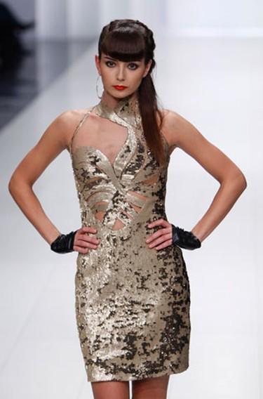 A model presents a creation by Ukrainian designer Ludmila Kislenko during Ukrainian Fashion Week in Kiev March 14, 2010. (REUTERS)