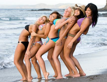 Girls just want to have fun. Priscilla, Jile, Sylvia, Deanna and Kesha dance on a sandy beach.