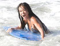 Surfer girl Deanna shows her best moves.