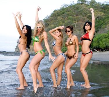 Deanna, Sylvia, Priscilla, Jile and Kesha dance on the beach.