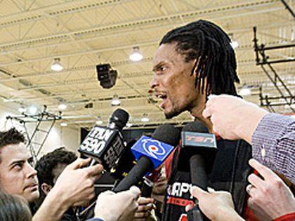 Raptors star Chris Bosh talks to reporters after practice on Monday. (Greg Henkenhaf/TORONTO SUN)