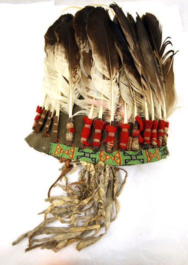 Belonged to Chief Bear Skin, Plains Cree, Nekaneet First Nation, Maple Creek, Saskatchewan. Made of immature golden eagle feathers, ermine (weasel) skins, loom beaded brow band, felt skull cap.(CRAIG ROBERTSON, Toronto Sun)