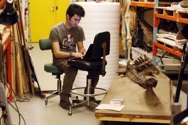 PhD student Michael Pittman with an ankylosaur (armoured dinosaur) skeleton, Late Cretaceous Period, 76 million years old. Found in Alberta. (CRAIG ROBERTSON, Toronto Sun)