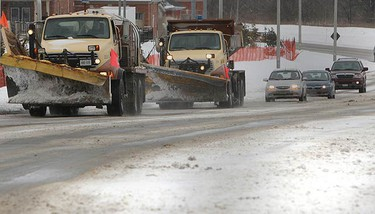 Traffic slows as snow removal crews throw salt along Donald Cousens Pkwy in Markham. (VERONICA HENRI, Toronto Sun)