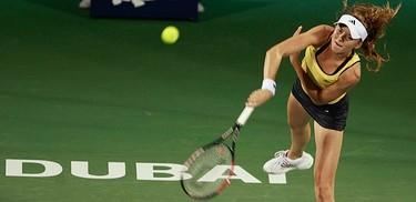 Daniela Hantuchova, of Slovakia, hits a return to Anastasia Pavlyuchenkova, of Russia, during their match at the WTA Dubai Tennis Championships, on Feb. 17, 2010.  (REUTERS)