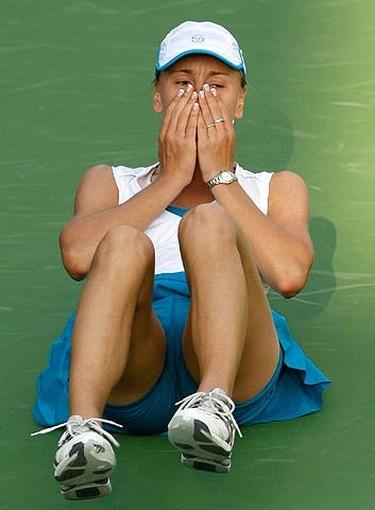 Regina Kulikova, of Russia, reacts after winning her match against compatriot Svetlana Kuznetsova at the WTA Dubai Tennis Championships on Feb. 17, 2010.  (REUTERS)