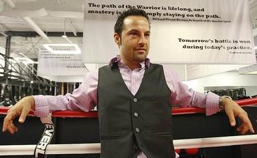 Joel Gerson leans on the ropes as he surveys his MMA studio.  (JACK BOLAND, Toronto Sun)