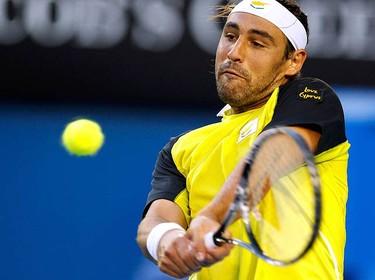 Marcos Baghdatis, of Cyprus, returns a shot against Australia's Lleyton Hewitt at the Australian Open tennis tournament in Melbourne on Jan. 23, 2010. (REUTERS)