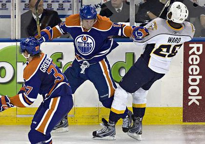 Edmonton Oilers Robert Nilsson holds up Nashville Predators Joel Ward. (Jordan Verlage/Edmonton Sun)