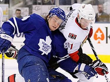 Maple Leafs forward Mikhail Grabovski battles for the puck with Senators forward Daniel Alfredsson Monday night at the Air Canada Centre. (GREG HENKENHAF/QMI Agency)
