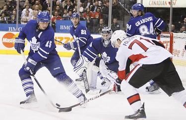 Ottawa Senators left wing Nick Foligno sets up Ottawa Senators centre Mike Fisher during an NHL hockey game in Toronto on Dec. 14, 2009. (GREG HENKENHAF, Toronto Sun)