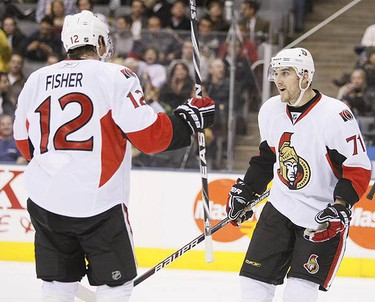 Ottawa Senators left wing Nick Foligno congratulates Ottawa Senators centre Mike Fisher after his second period goal during an NHL hockey game in Toronto on Dec. 14, 2009. (GREG HENKENHAF, Toronto Sun)