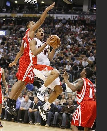 Raptors guard DeMar DeRozan drives to the net during an NBA basketball game against the Houston Rockets in Toronto on Dec. 13, 2009. (GREG HENKENHAF, Toronto Sun)