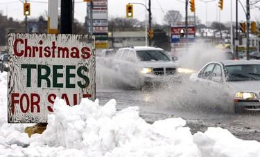 A sloppy day around Toronto as rain followed a morning snowfall. (Toronto Sun/Micheal Peake)