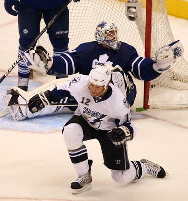 Tampa Bay's #12, Ryan Malone, beats Toronto goalie, Jonas Gustavsson in overtime. Tampa Bay beat The Toronto Maple Leafs in overtime 2-1. (Toronto Sun/Craig Robertson)