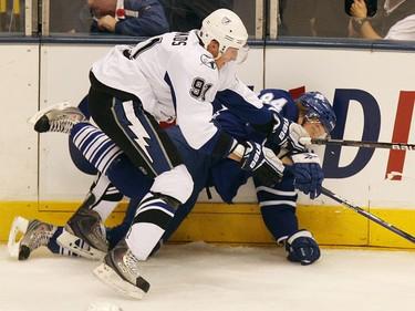 Mikhail Grabovski gets nailed by Steven Stamkos.Toronto Maple Leafs vs Tampa Bay Lightning. (Tornto Sun/Craig Robertson)
