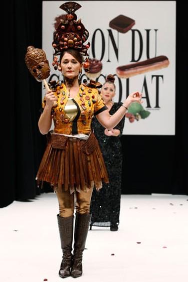 French TV host Daniela Lumbroso presents a creation at the 15th Salon du Chocolat (Paris Chocolate Show) in Paris October 13, 2009. (REUTERS)
