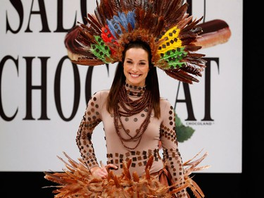 French actress Carole Brana presents a creation at the 15th Salon du Chocolat (Paris Chocolate Show) in Paris October 13, 2009. (REUTERS)