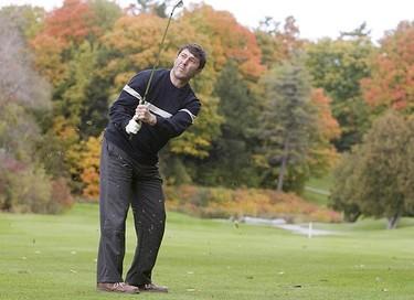 Golfing is 47-year-old Anastasios Minakis of Toronto at Glen Cedars Golf Club on this yearly Thanksgiving tradition. (GREG HENKENHAF, Sun Media)