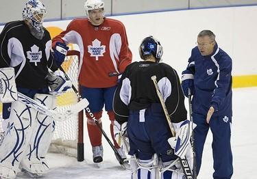 Goalie coach Francois Allaire talking to Vesa Toskala  as Jonas Gustavsson and Nikolai Kulemin look on during Leafs practice in Toronto, on Oct. 5, 2009. (ALEX UROSEVIC, Sun Media)