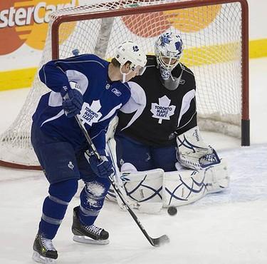 Matt Stajan and Jonas Gustavsson during Leafs practice in Toronto, on Oct. 5, 2009. (ALEX UROSEVIC, Sun Media)
