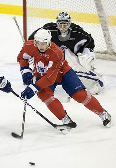 Nikolai Kulemin and Vesa Toskala during Leafs practice in Toronto, on Oct. 5, 2009. (ALEX UROSEVIC, Sun Media)